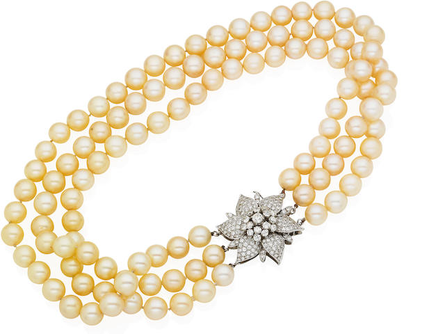 A triple-strand cultured pearl and diamond necklace