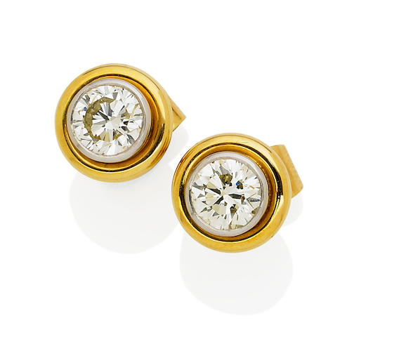 A pair of diamond earrings, by Percy Marks