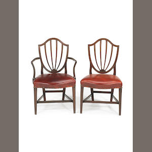 A set of twelve George III mahogany dining chairs including a pair of armchairs, in the manner of Gillows