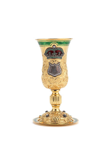 A Continental yellow metal and gem set chalice and paten Maker's mark 'SC' below three circles set out in a triangle formation surmounted by a crown, 750 standard mark
