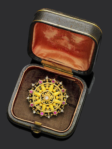 A gold, ruby and diamond Etruscan revival brooch,