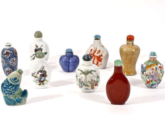 A group of ten porcelain snuff bottles and stoppers