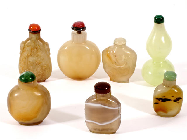 A group of seven jade, agate and hardstone snuff bottles and stoppers,