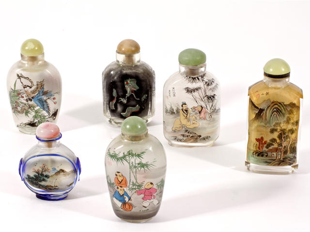 A group of six inside painted snuff bottles and stoppers,