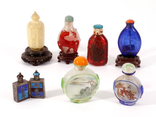 Seven glass, ivory, metal and amber snuff bottles and stoppers