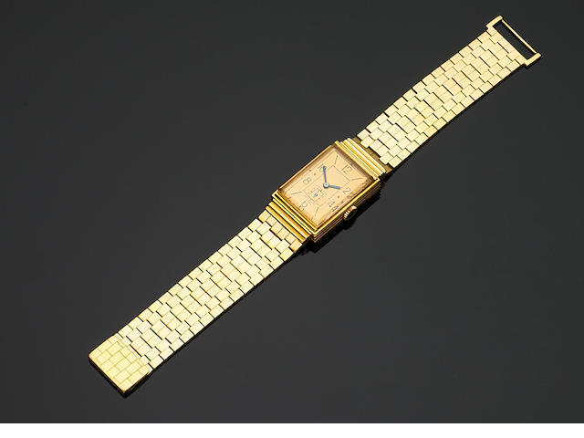 A retro gold wristwatch,