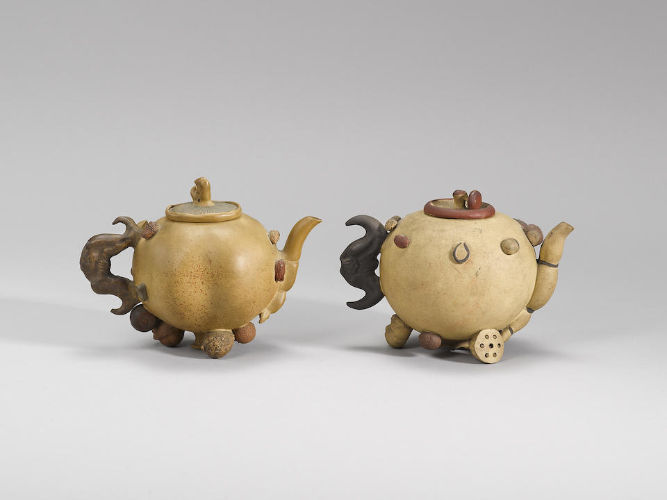 Two Yixing stoneware 'hundred-fruit' teapots and covers Qing dynasty, one signed Wang Zhiyuan, the other signed Ji An