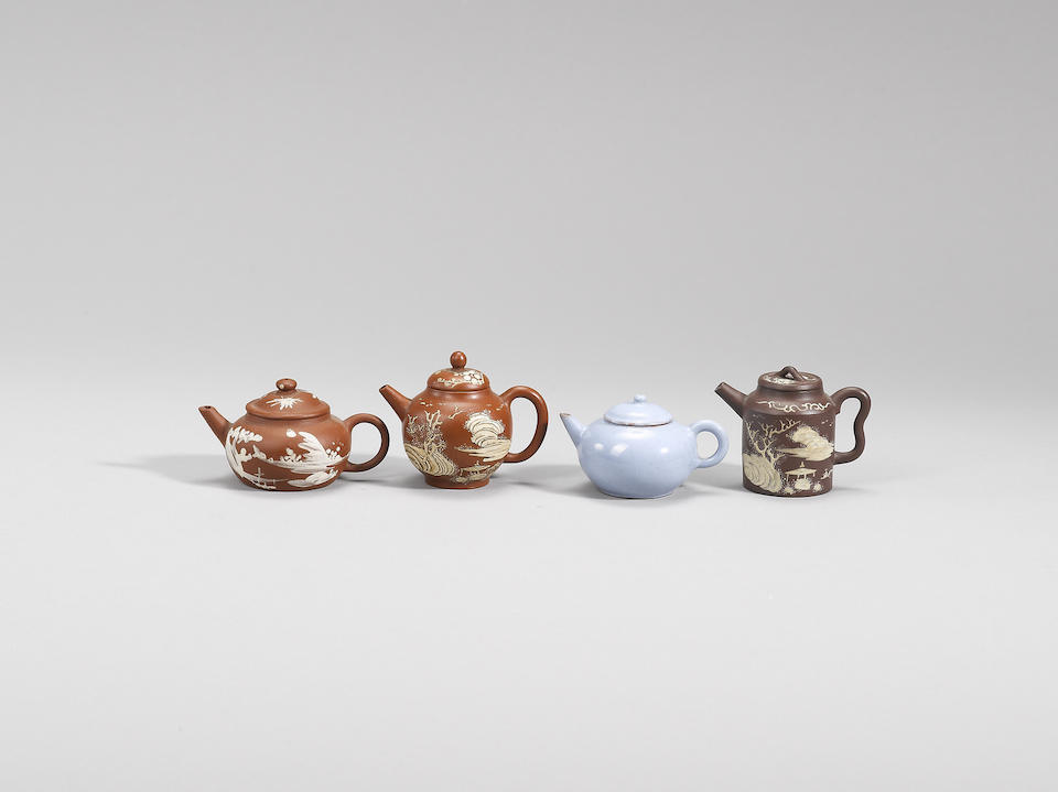 A small Yixing stoneware slip-painted teapot and two Yijun teapots and covers Qing dynasty
