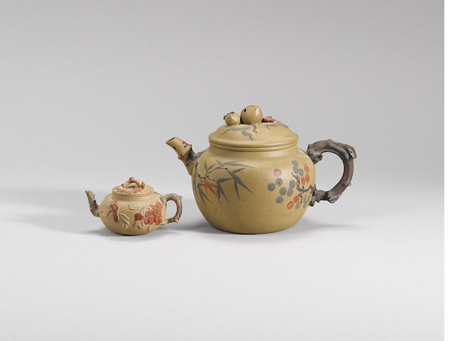 Two Yixing stoneware moulded and slip-painted teapots and covers Qing dynasty
