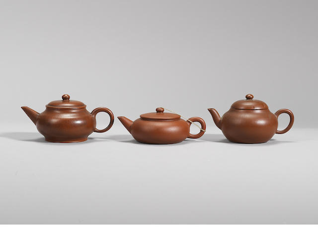 Three Yixing stoneware teapots and covers Qing dynasty, signed Hui Mengchen