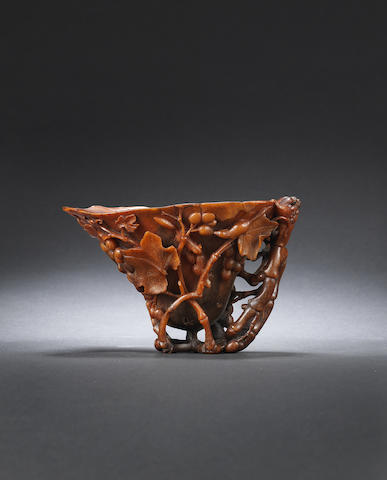 A finely carved 'grapes and squirrels' rhinoceros horn libation cup Early Qing dynasty