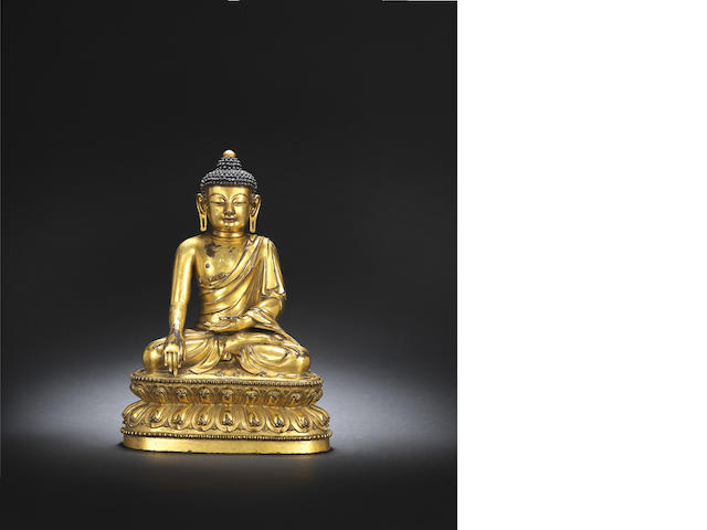 A rare gilt-bronze figure of Shakyamuni Xuande incised six-character mark and of the period