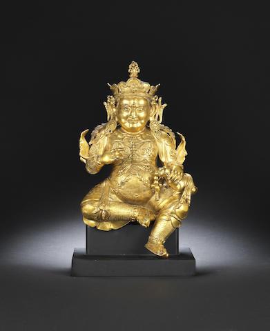 A gilt-bronze figure of Jambhala Early Qing dynasty