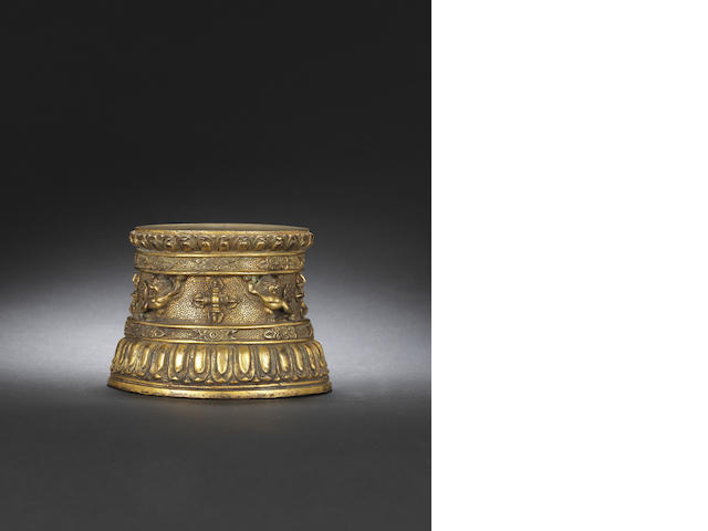 An extremely rare gilt-bronze circular stand Early Ming dynasty