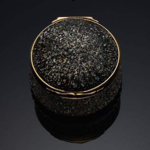 A mid 18th century German gold-mounted granite circular snuff box Unmarked, probably German