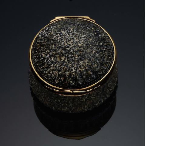 A mid 18th century German gold-mounted granite circular snuff box  Unmarked, probably German,