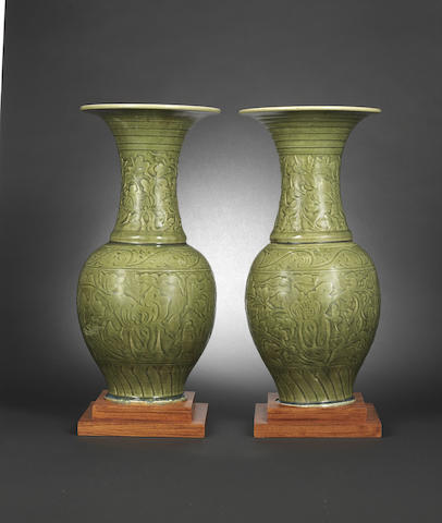 A pair of Longquan carved celadon trumpet-neck vases Yuan/early Ming dynasty