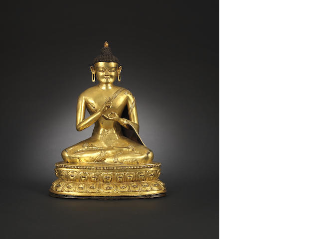 A large gilt-bronze figure of Shakyamuni 14th century