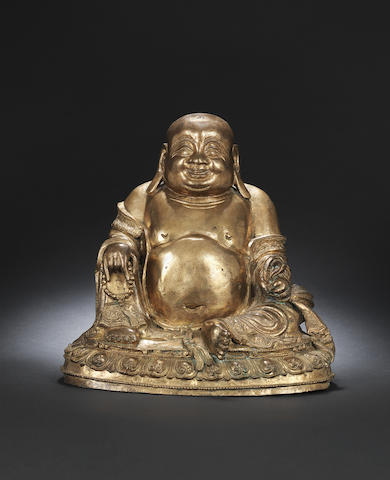 A gilt-bronze figure of Budai Late Ming dynasty