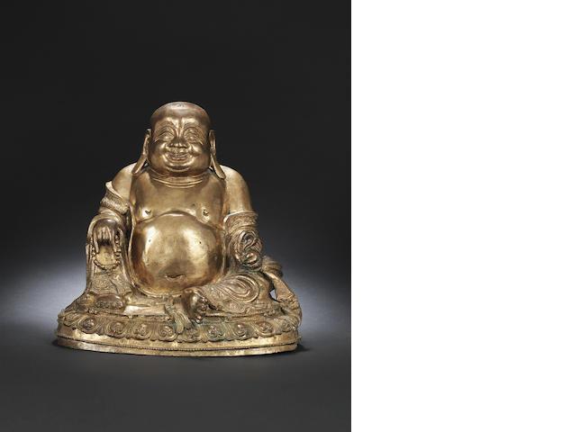 A gilt-bronze figure of Budai Late Ming dynasty