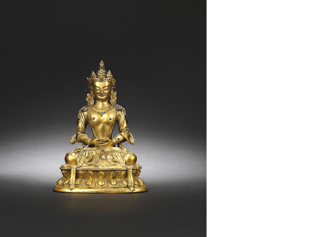 A gilt-bronze figure of Avalokiteshvara Kangxi