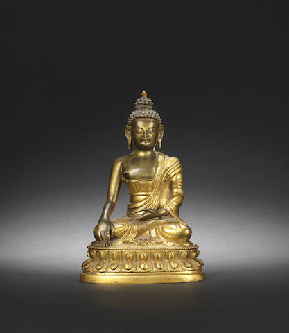 A gilt-bronze figure of Sakyamuni Qianlong