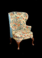 A George I walnut wing armchair