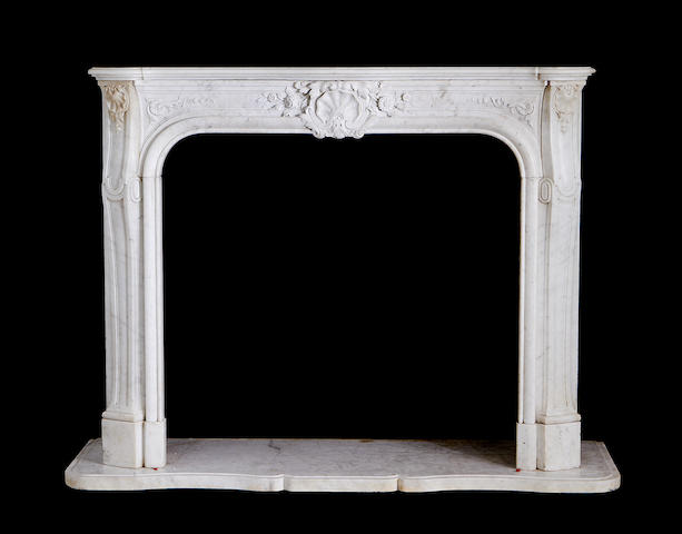 A late 19th century French Carrara marble chimneypiece in the Louis XV style