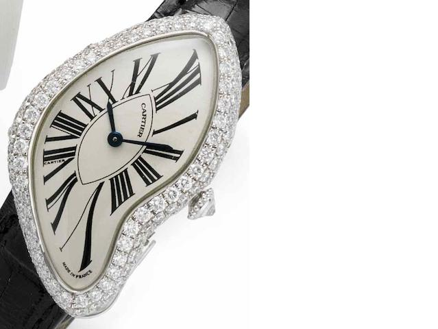 Cartier. A lady's 18ct white gold and diamond set manual wind wristwatch Crash, Case No.124898 AF, Movement No.8970MC, Recent