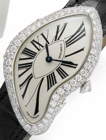 Cartier. A lady's 18ct white gold and diamond set manual wind wristwatch Crash, Case No.124898 AF, Movement No.8970MC, Recent