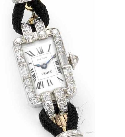 Cartier. A lady's platinum diamond set manual wind wristwatch