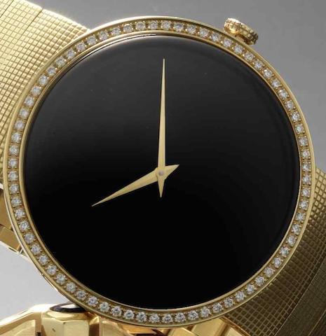 Christian Dior. An 18ct gold quartz bracelet watch