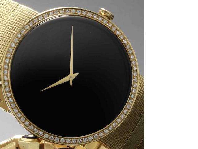 Christian Dior. An 18ct gold quartz bracelet watch