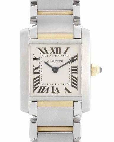 Cartier. A lady's stainless steel and gold quartz bracelet watch Tank, Recent