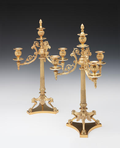 A pair of Victorian silver-gilt four-light Etruscan Revival candelabra By Finley and Taylor, London 1891