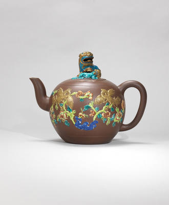 An Yixing stoneware 'famille-rose' enamelled 'lion' teapot and cover Qing dynasty, signed Han Zhen