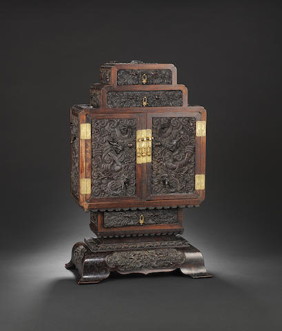 A magnificent finely carved Imperial zitan 'dragon' cabinet and stand Qianlong
