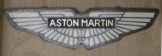 An 'Aston Martin' garage display emblem,
