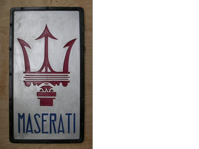 A hand-painted fibreglass 'Maserati' garage display sign,