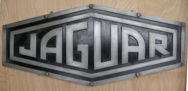 A 'Jaguar' garage display emblem,