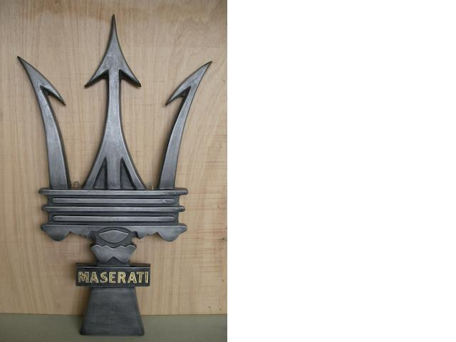 A 'Maserati Trident' garage display emblem,