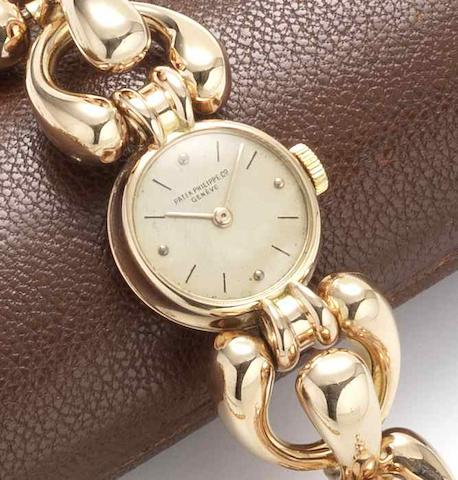 Patek Philippe. An lady's unusual 18ct gold manual wind bracelet watch Case No.642024, Movement No.941996, Circa 1955