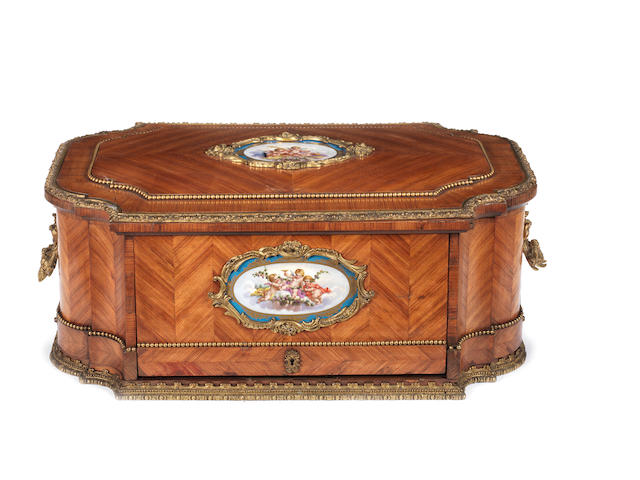 A French mid-19th century porcelain and ormolu-mounted tulipwood parquetry and burr-ash carrying secrétairepossibly by Alphonse Giroux, Paris