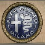 A hand-painted 'Alfa Romeo-Milano' decorative roundel,