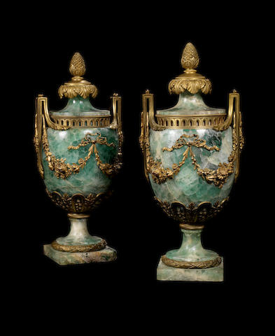 A pair of French late 19th century Louis XVI style, ormolu-mounted green Spath Fluor urns