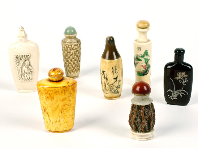 A group of six ivory and one inlaid wood snuff bottles and stoppers