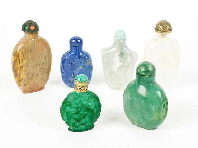 A group of six glass and hardstone snuff bottles and stoppers
