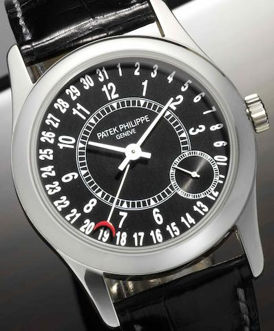Patek Philippe. A fine 18ct white gold automatic calendar wristwatchCalatrava, Ref:6000G, Case No.4326037, Movement No.3511745, Made in 2005