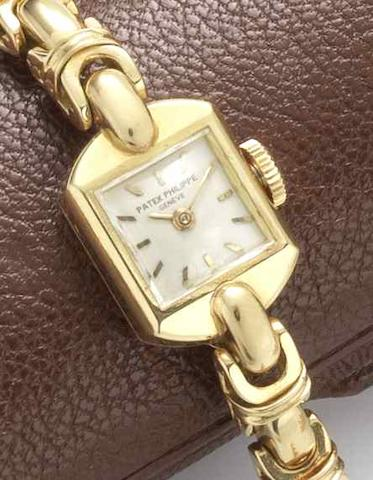 Patek Philippe. A lady's 18ct gold manual wind bracelet watch Ref:3035, Case No.673242, Movement No.946441, Circa 1960