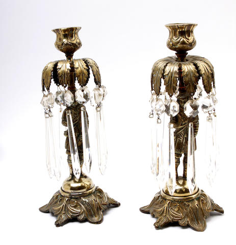 A pair of French figural laquered brass candlesticks, Late 19th century,